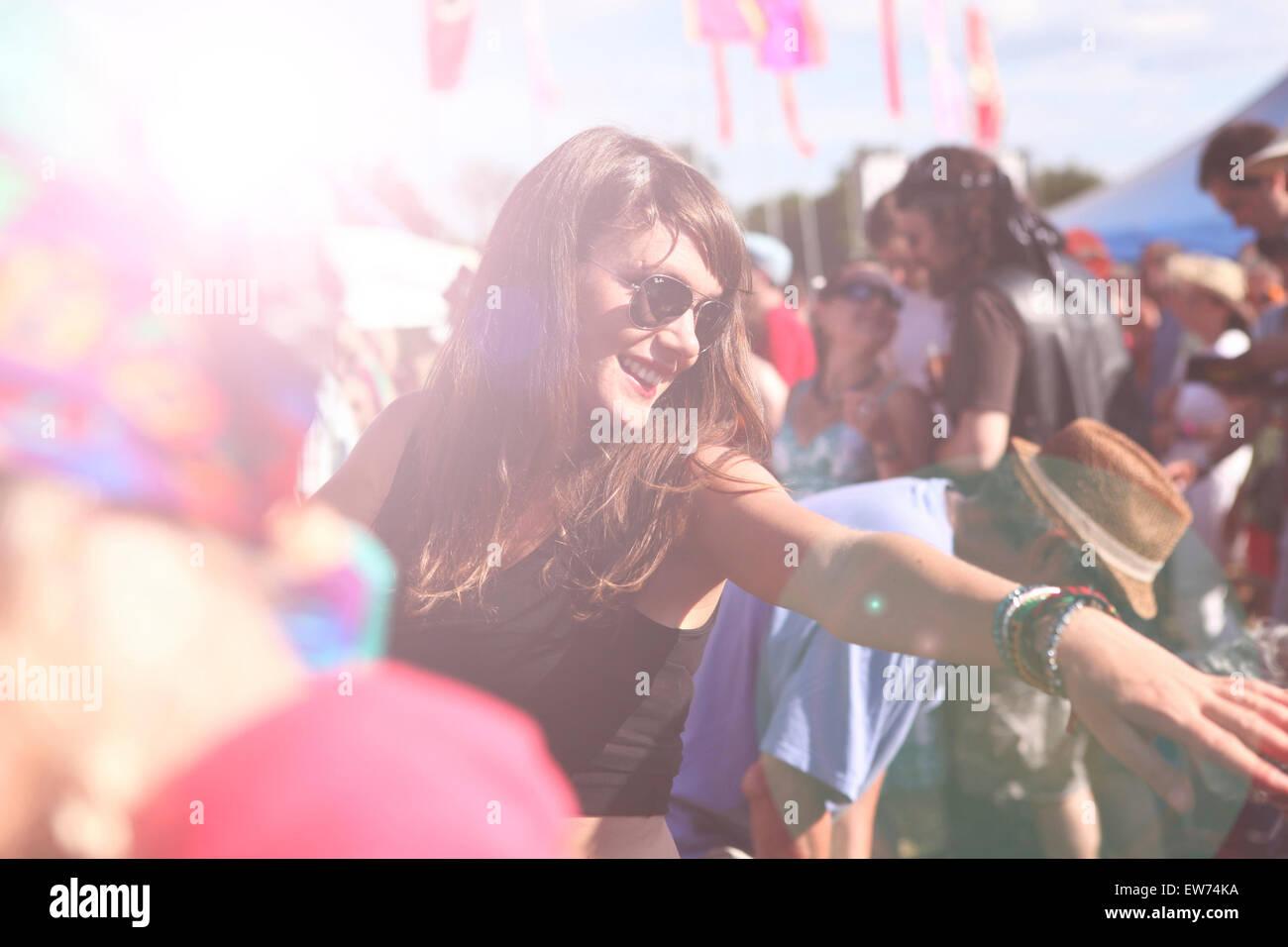Girl dancing at summer music festival - Stock Image