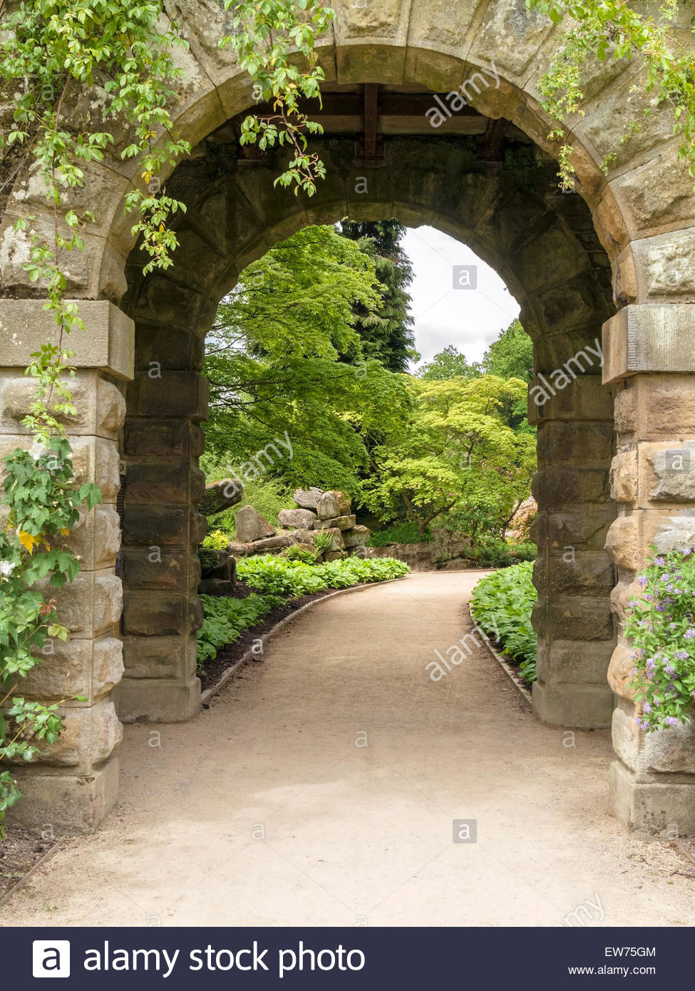 Archway entrance to Paxton's Rock Garden, Chatsworth, Derbyshire, England, UK. - Stock Image