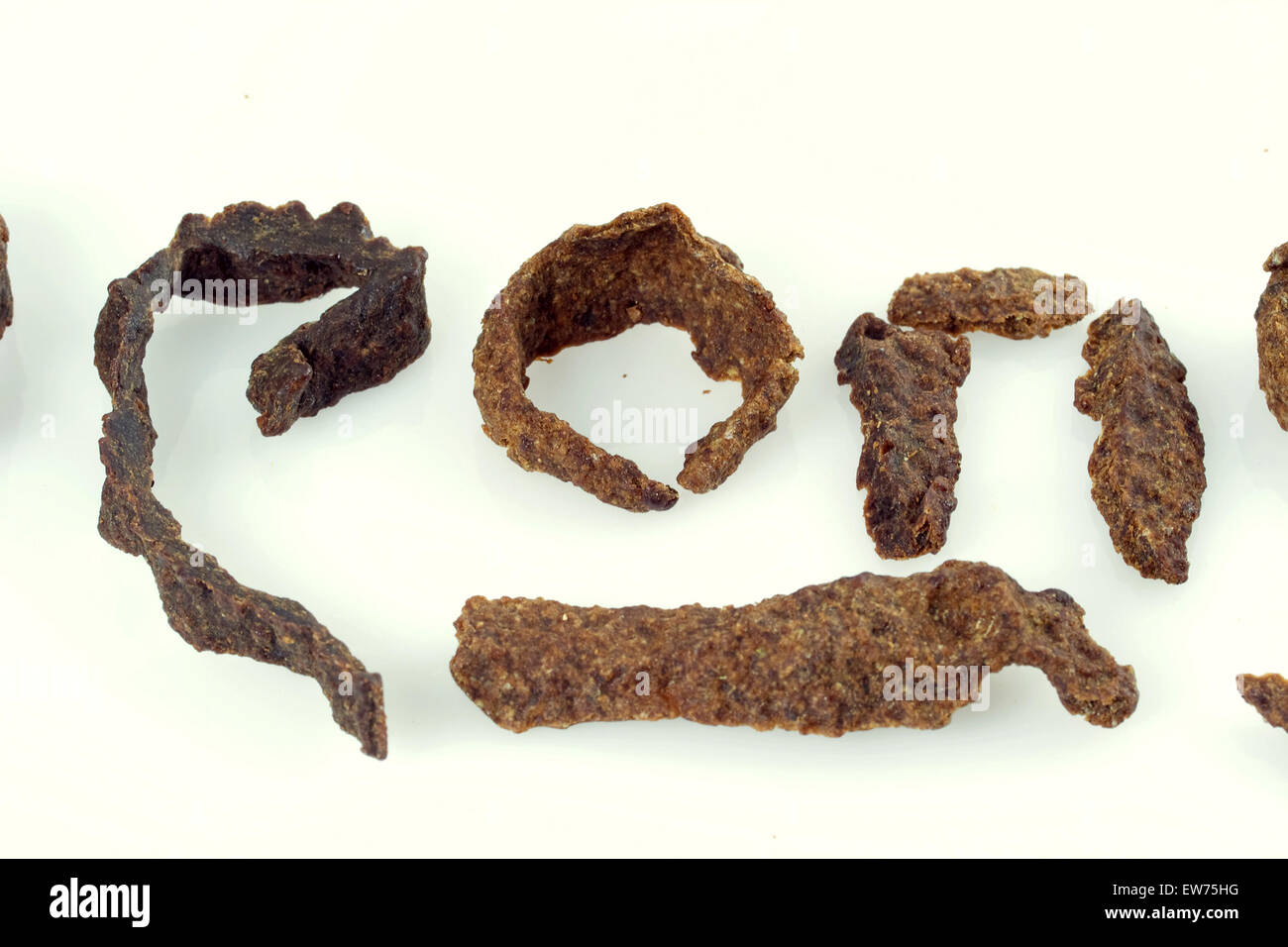 Greek letters ROP (pROPolis) formed by raw fresh, apis honey bee propolis chewing stick bars, macro detail - Stock Image
