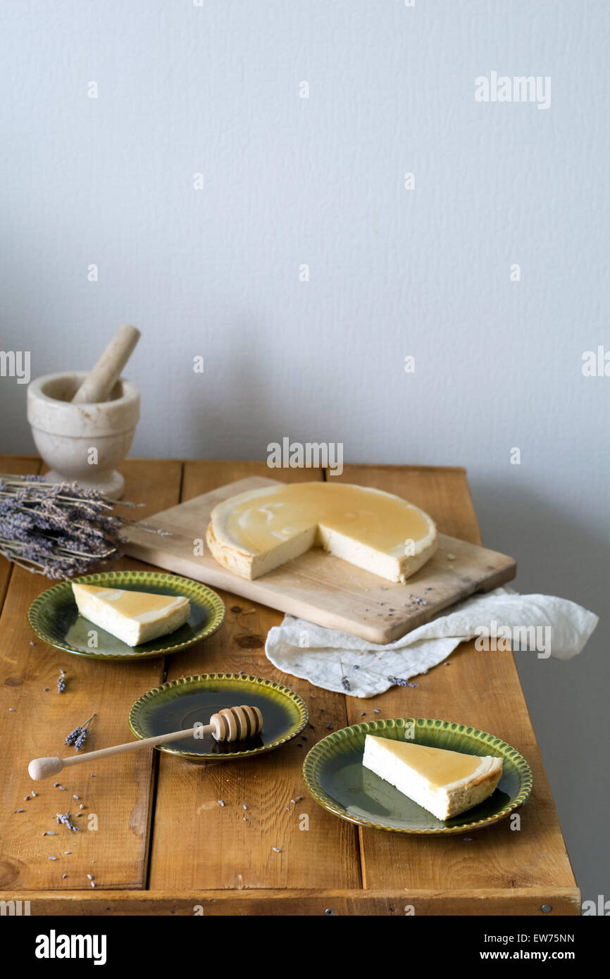 Melopita - traditional greek ricotta and honey cake on wooden table, rustic style still life - Stock Image