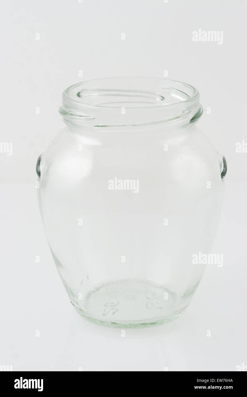 open transparent empty glass jar without lid isolated in white stock