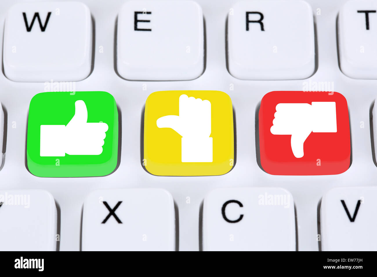 Choosing customer service quality feedback with thumbs up and down on computer keyboard - Stock Image