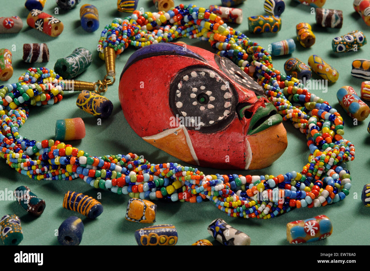 """Beaded Kenyan necklace with small Cameroon""""passport"""" mask and West Africcan glass beads Stock Photo"""