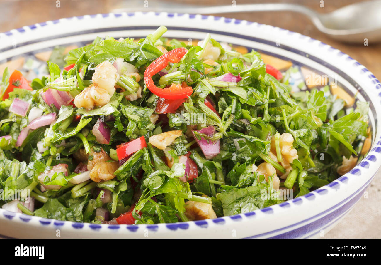 Moroccan Salad with parsley, chilis, red onion, tomato, walnuts and pomegranate syrup - Stock Image