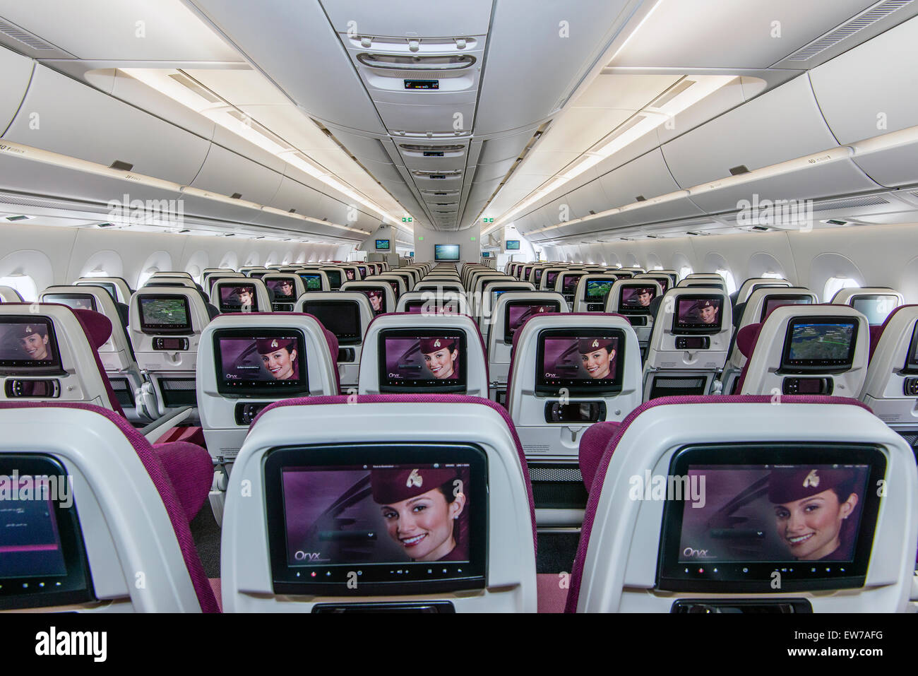 Interior view of the economy class section of the Qatar Airways Airbus A350-900 - Stock Image