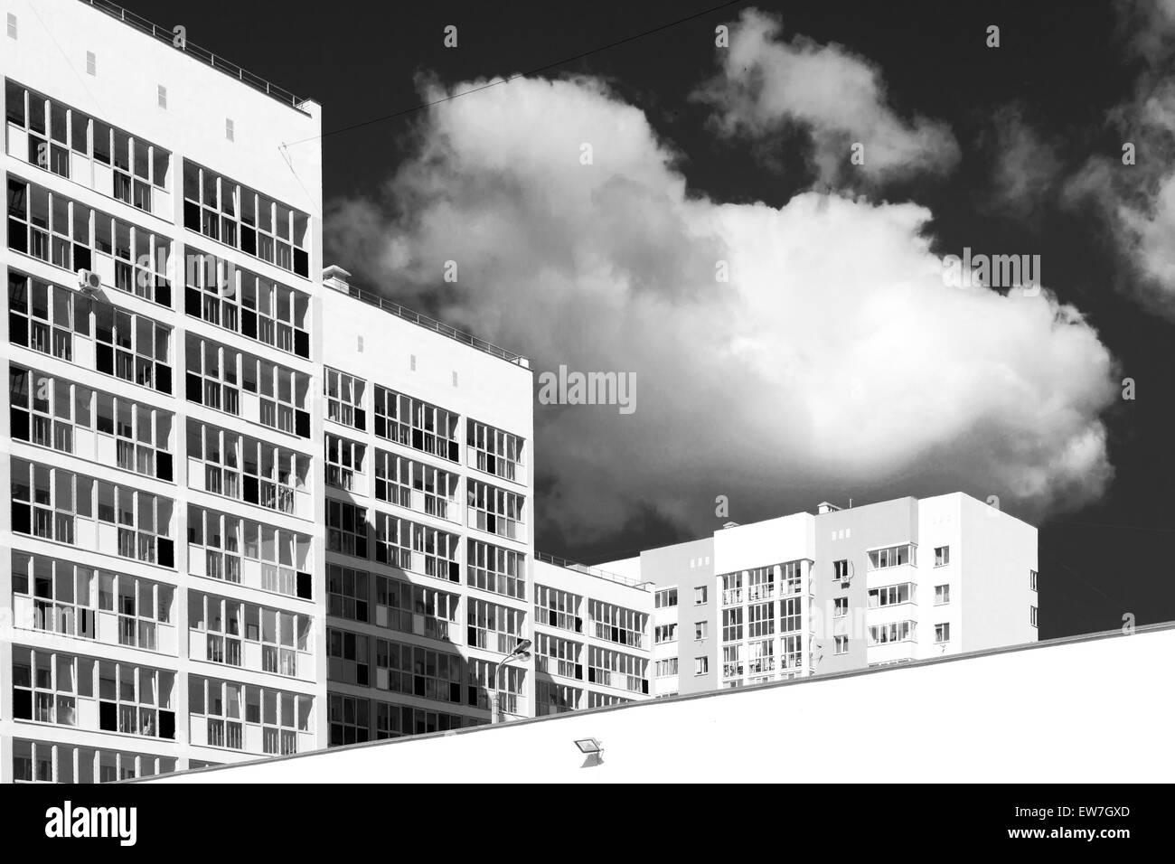 Newly designed and built modern housing blocks in unsaturated black and white - Stock Image