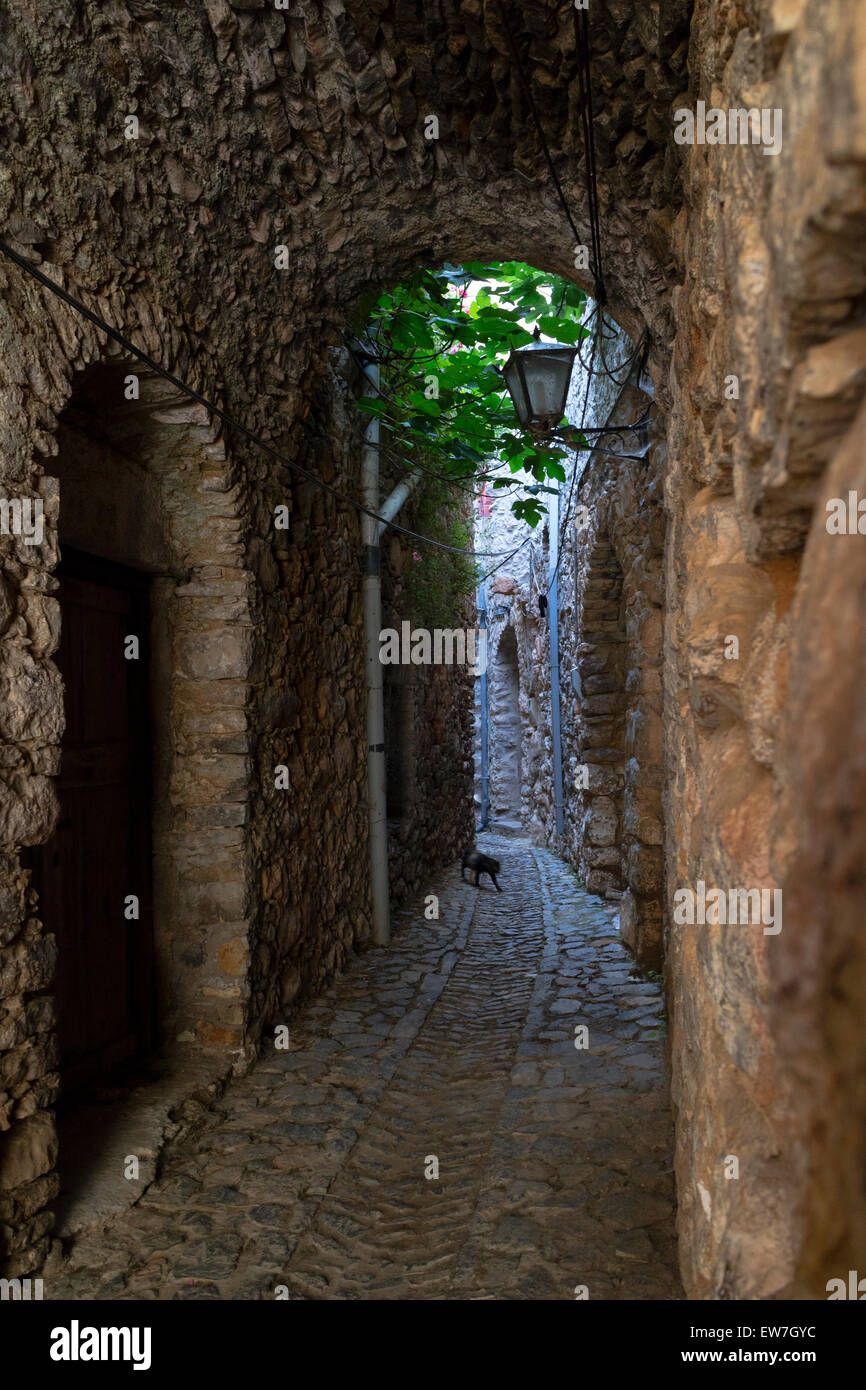 Small alley with bows in the medieval village of Mesta, on the isle of Chios, Greece - Stock Image