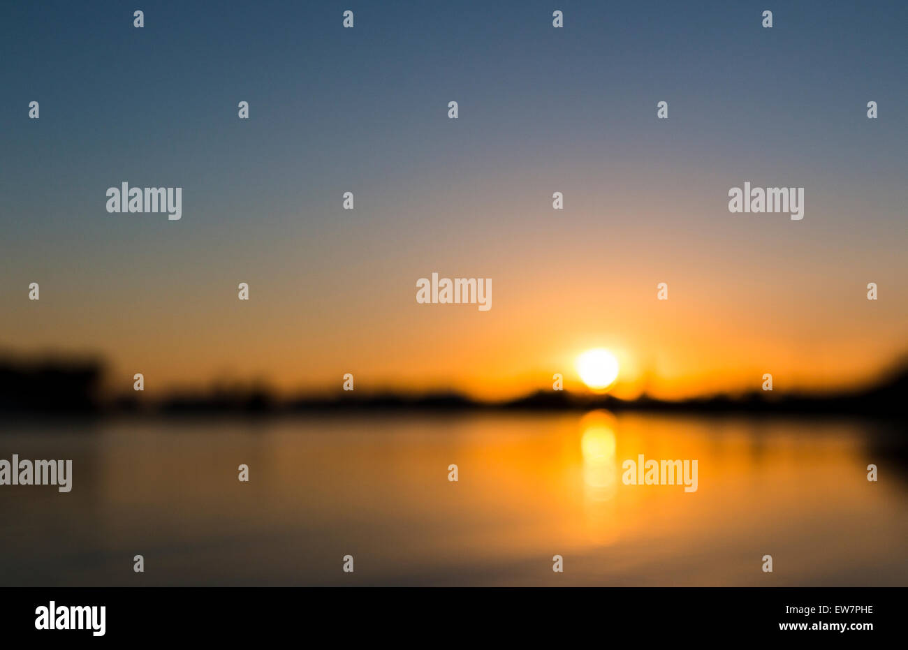 Orange Sunset Over River Daugava Riga Europe Blurred Background Nobody No People Night Evening Dusk - Stock Image