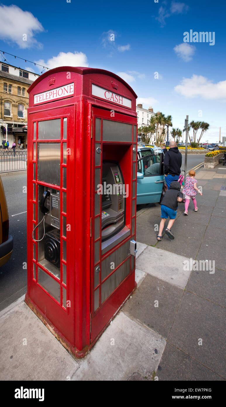 UK, Wales, Conwy, Llandudno, Gloddaeth Street, K6 phone box converted into cash machine Stock Photo