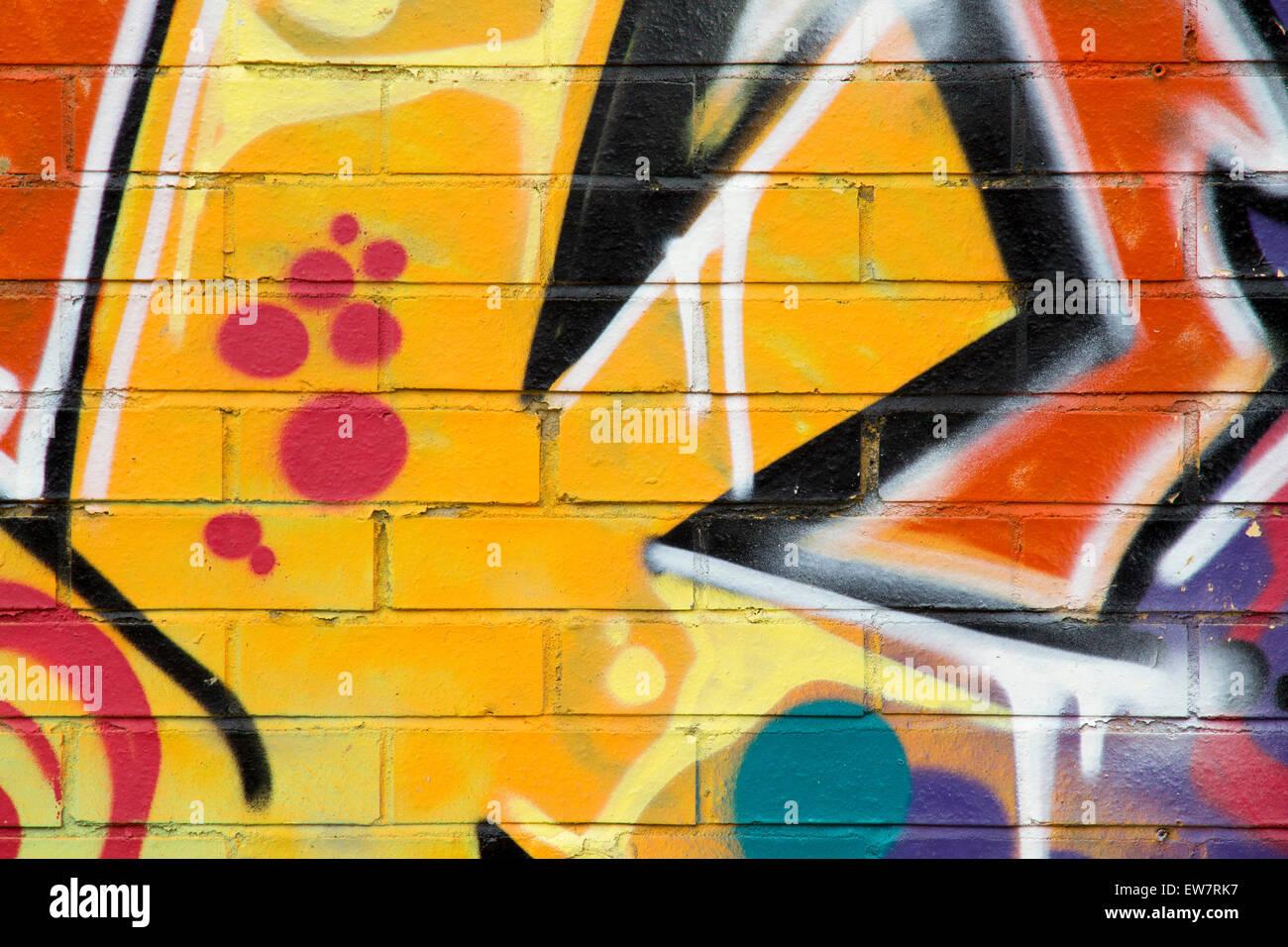 BRIGHTON - MAY 22, 2015. Street art graffiti on an old brick wall in ...