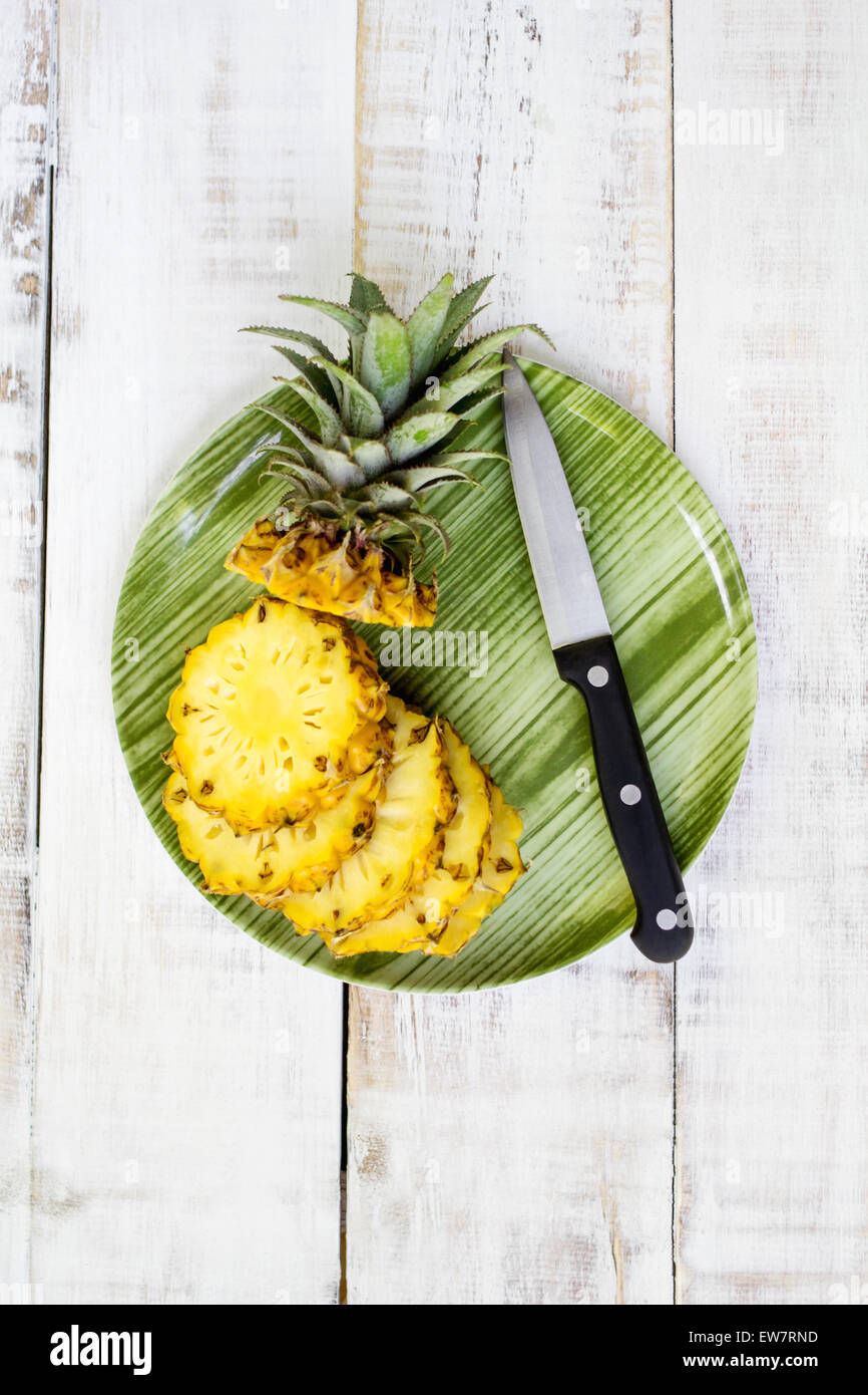 Elevated view of a pineapple on a plate - Stock Image