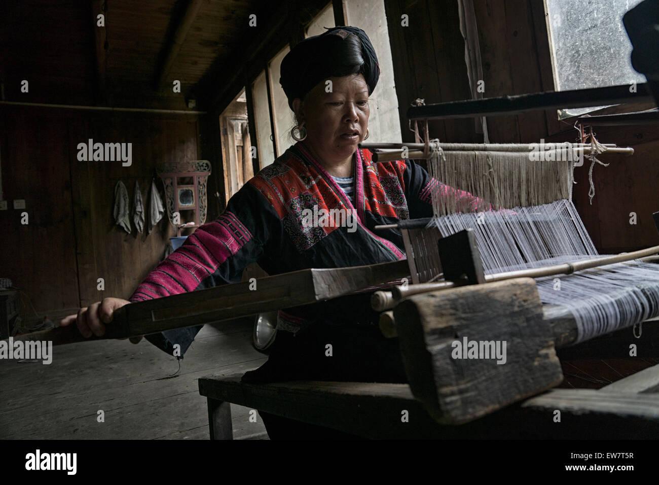Chinese woman weaving fabric, Longsheng Village, Guilin, China - Stock Image