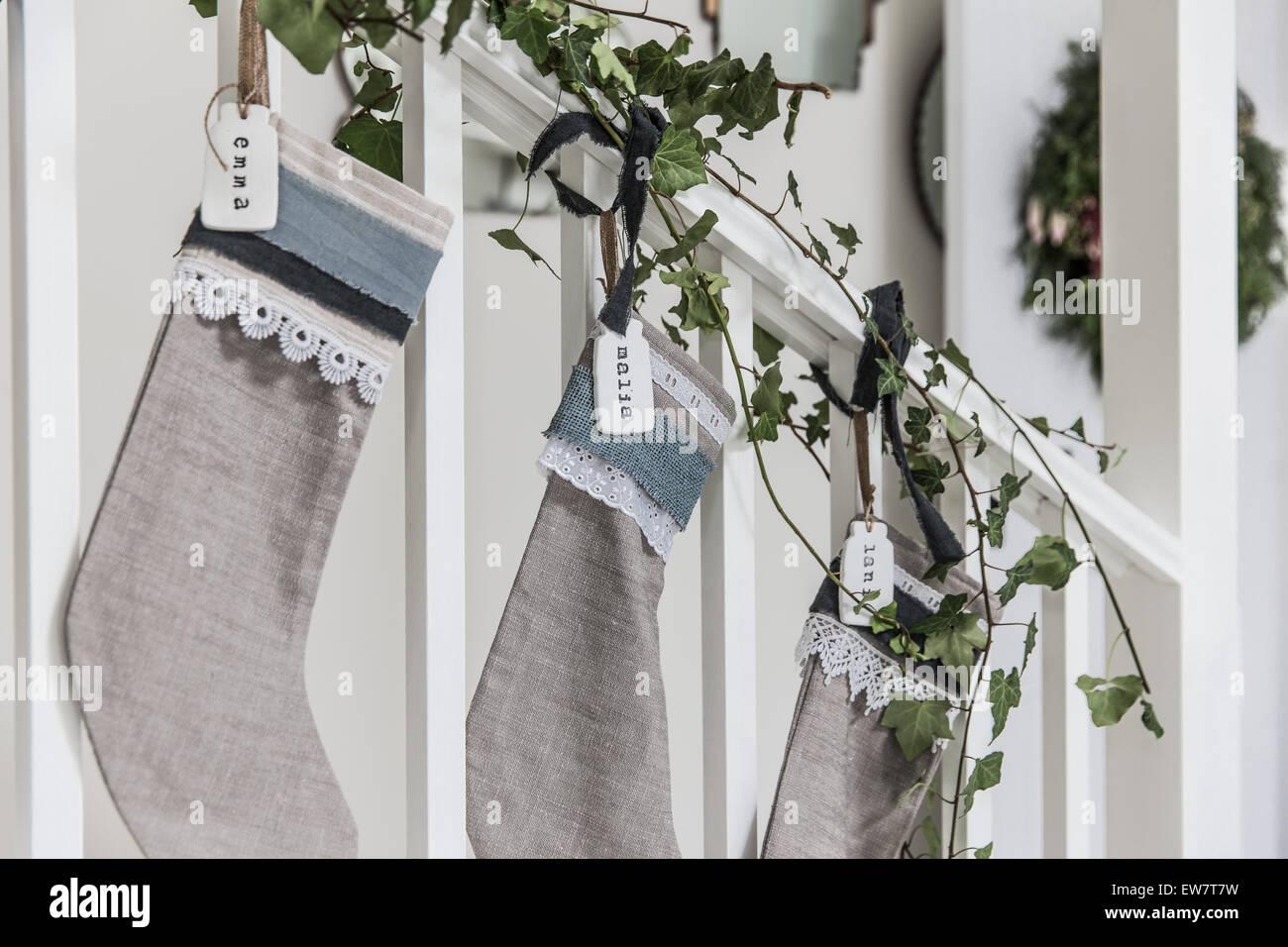 Christmas stockings with homemade nametags - Stock Image