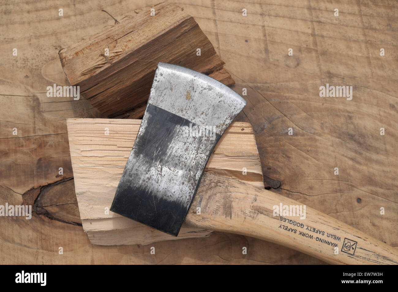 Small chopping axe for splitting firewood logs UK - Stock Image