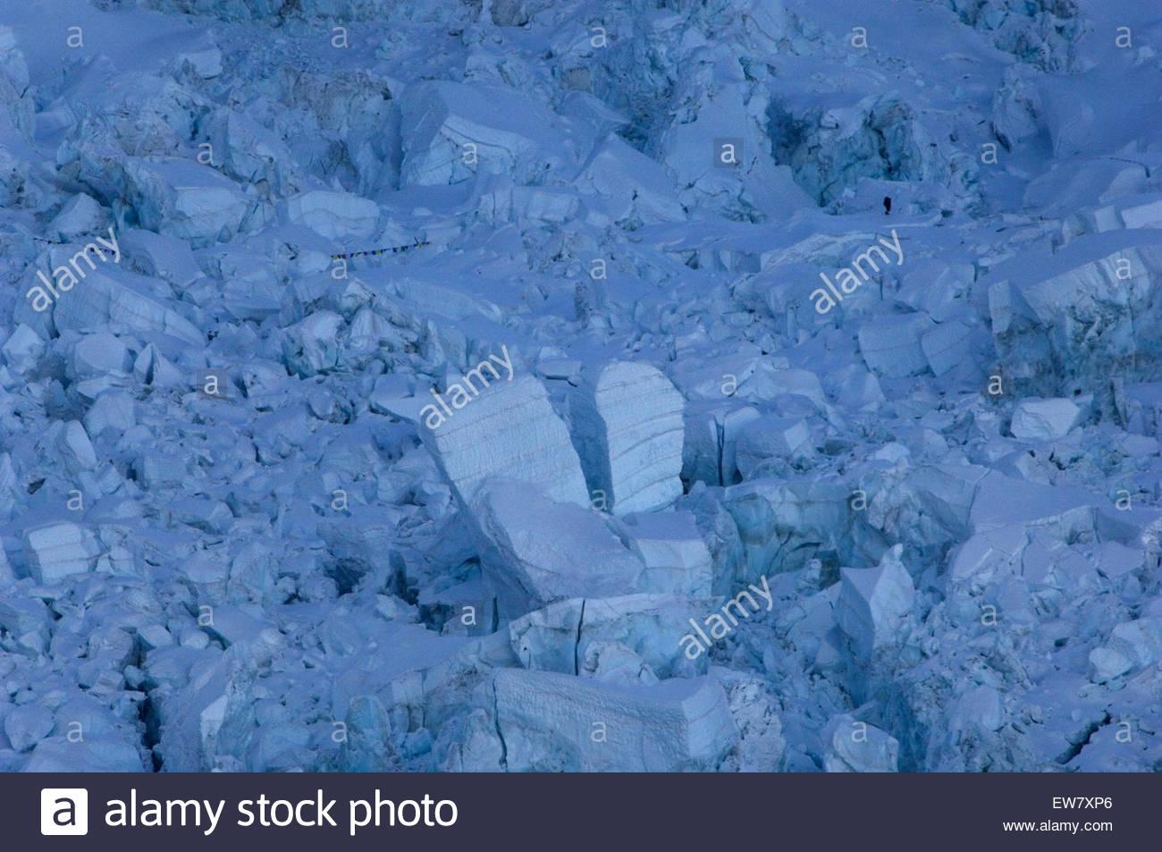 A climber negotiates Everest's Khumbu Icefall, Nepal. - Stock Image