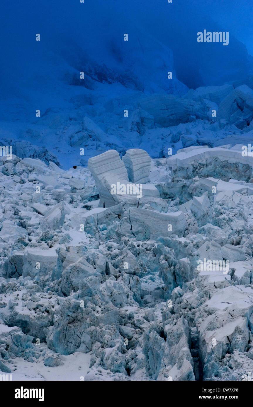 Climber negotiating Everest's Khumbu Icefall, Nepal. - Stock Image