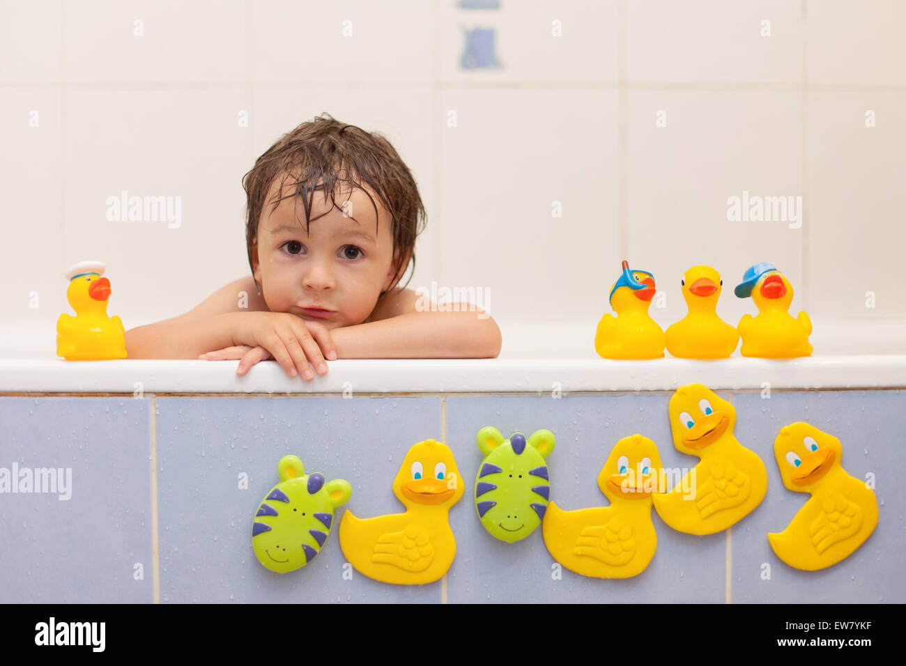 Adorable little boys in bathtub with his rubber duckies Stock Photo ...