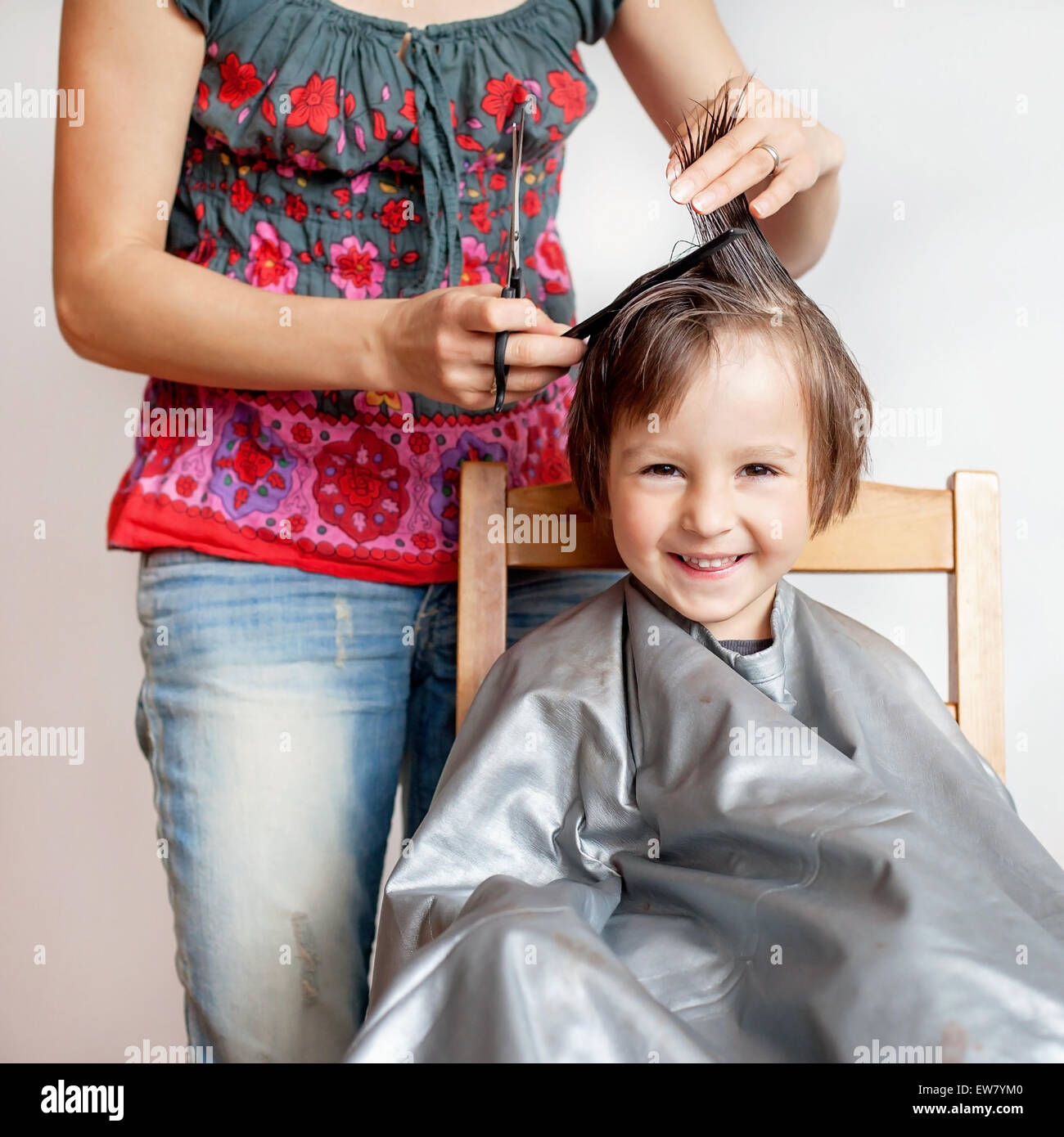 Cute Little Boy Having Haircut Smiling Happily White Background