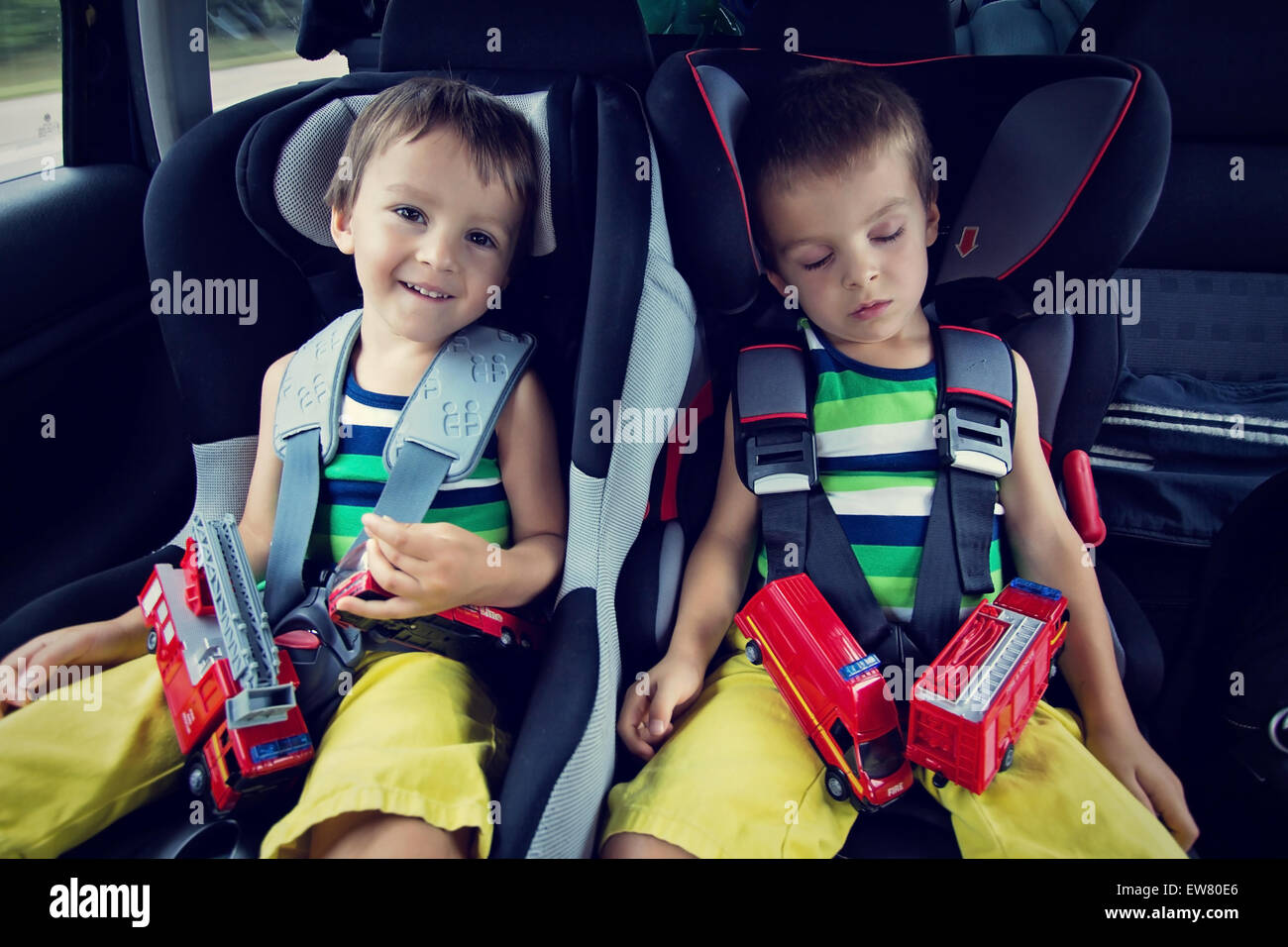 Two sweet boys, sleeping in the car with teddy bears after a long ...
