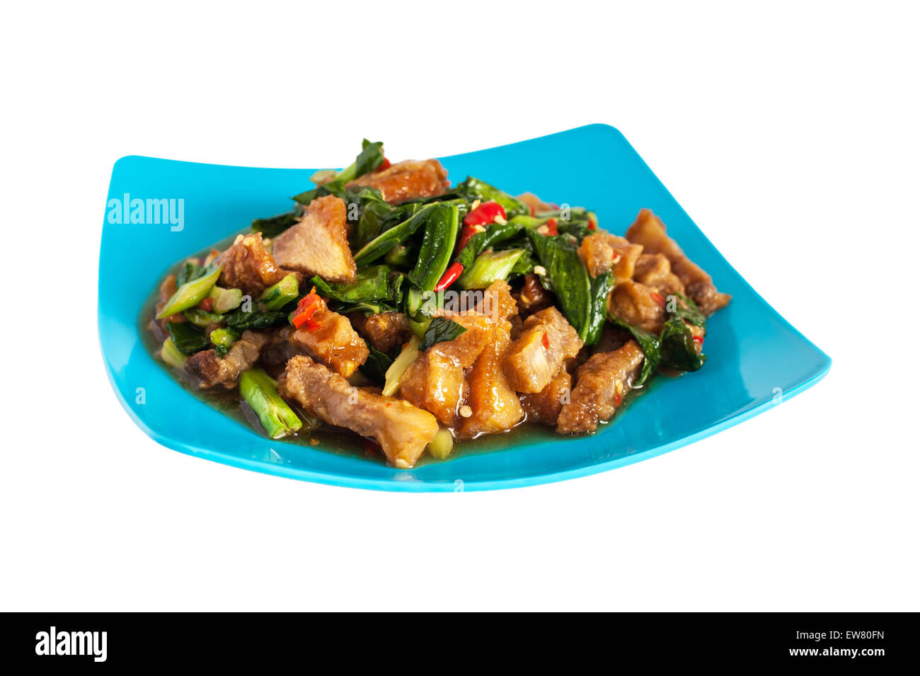 Thai food fried kale with crispy pork, Isolated on white background