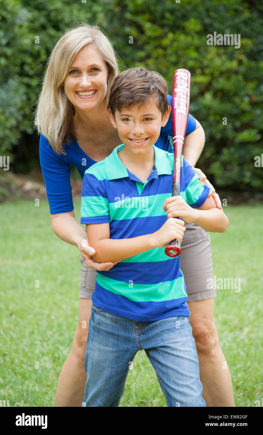 Mother And Son Playing Soccer Stock Photo - Download Image
