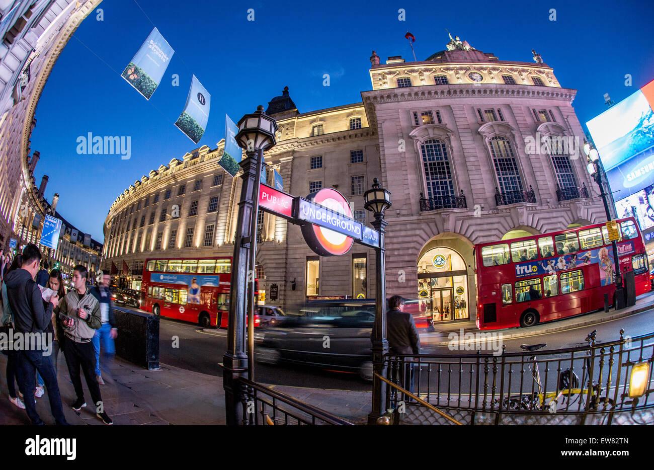 Piccadilly Circus Underground Station Entrance  at Night London UK - Stock Image