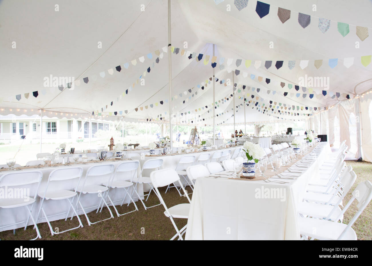 Tables and tent Country style wedding reception n backwoods of Stock ...