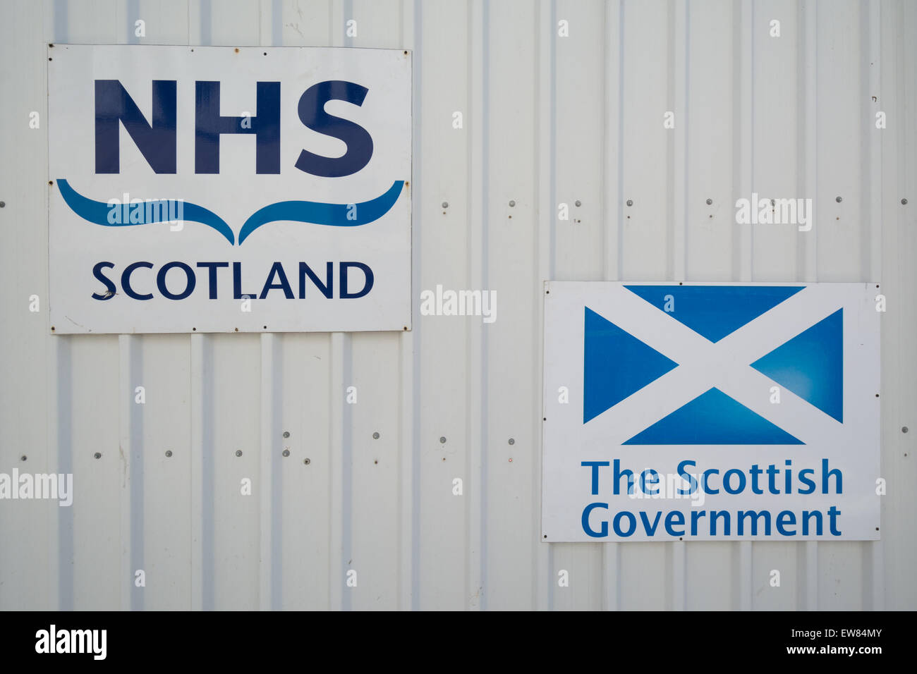 NHS Scotland and The Scottish Government signs erected during the construction of the new South Glasgow University - Stock Image