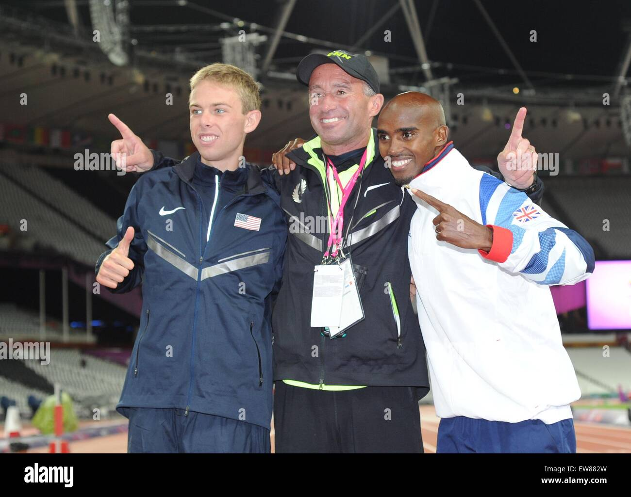 Galen Rupp, Alberto Salazar and Mo Farah celebrate after winning medals in the 10,000 m at the London 2012 Olympic - Stock Image