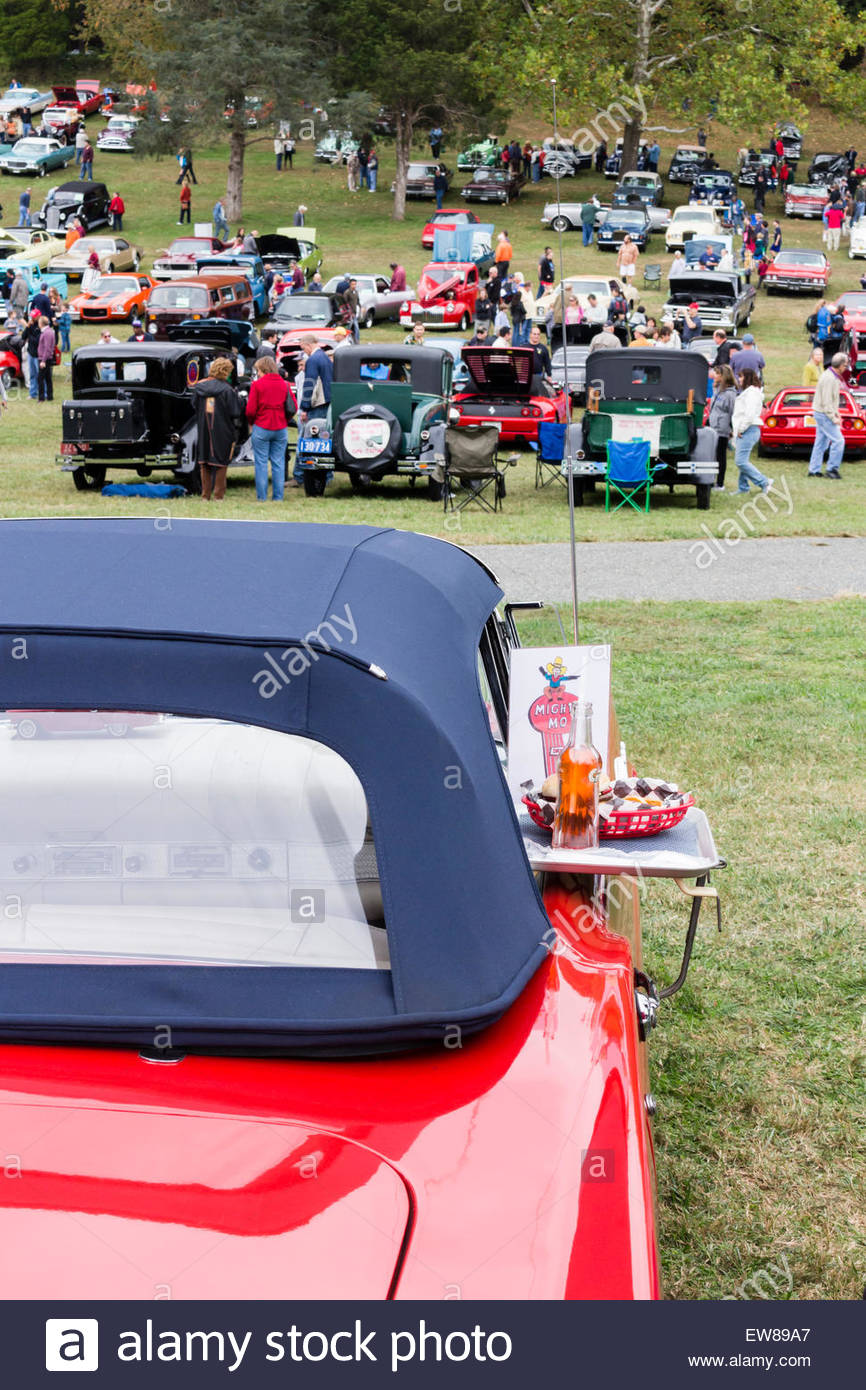 A vintage Mighty Mo drive-in restaurant meal tray sits on a red convertible sports car at the 2014 Rockville Antique - Stock Image