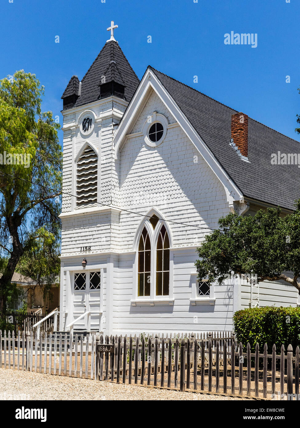 Front exterior view of the1897 white wooden Presbyterian Church in Santa Ynez, California. - Stock Image