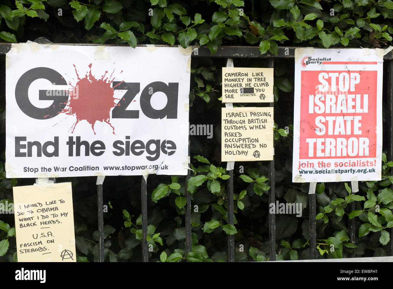 Stop the war Crimes against Gaza and Palestine posters attached to railing in London - Stock Image