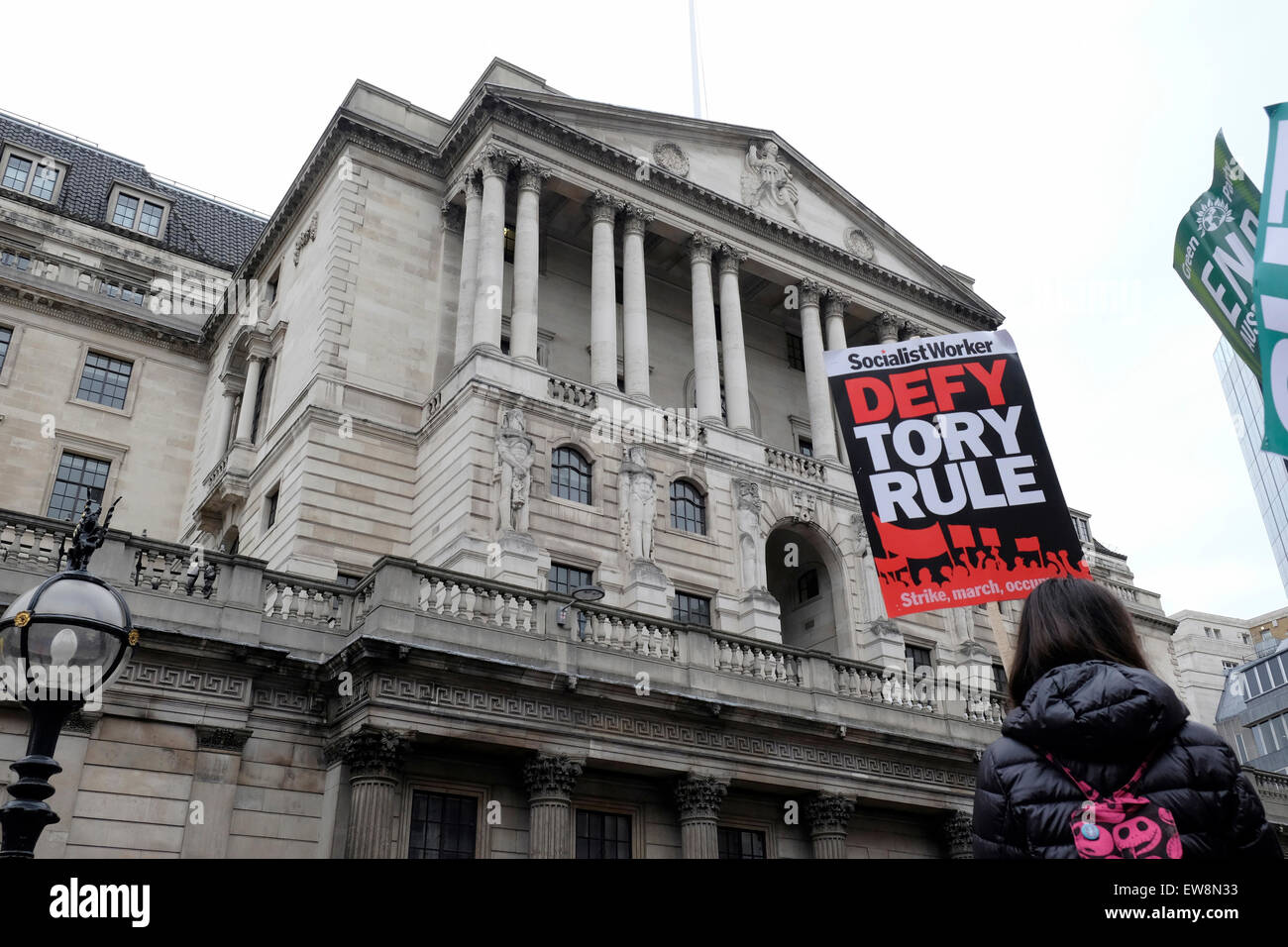A protester outside the Bank of England holds a placard reading ' defy Tory rule' - Stock Image
