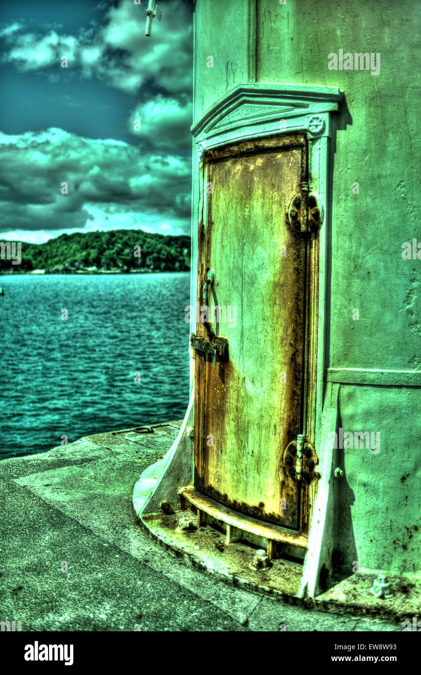 Rusty door of a lighthouse, processed as an HDR image. Stock Photo