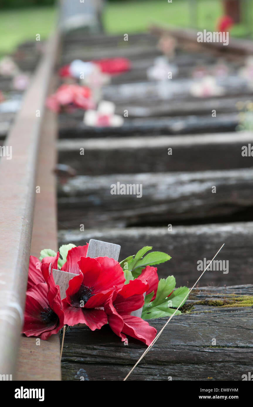 Floral Tributes on the Burma Railway Track at The National Memorial Arobretum, near Lichfield in Staffordshire England - Stock Image