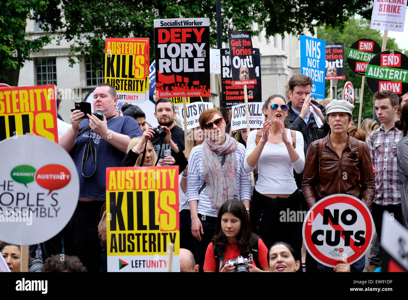 Anti-austerity protesters outside Downing Street, London - Stock Image