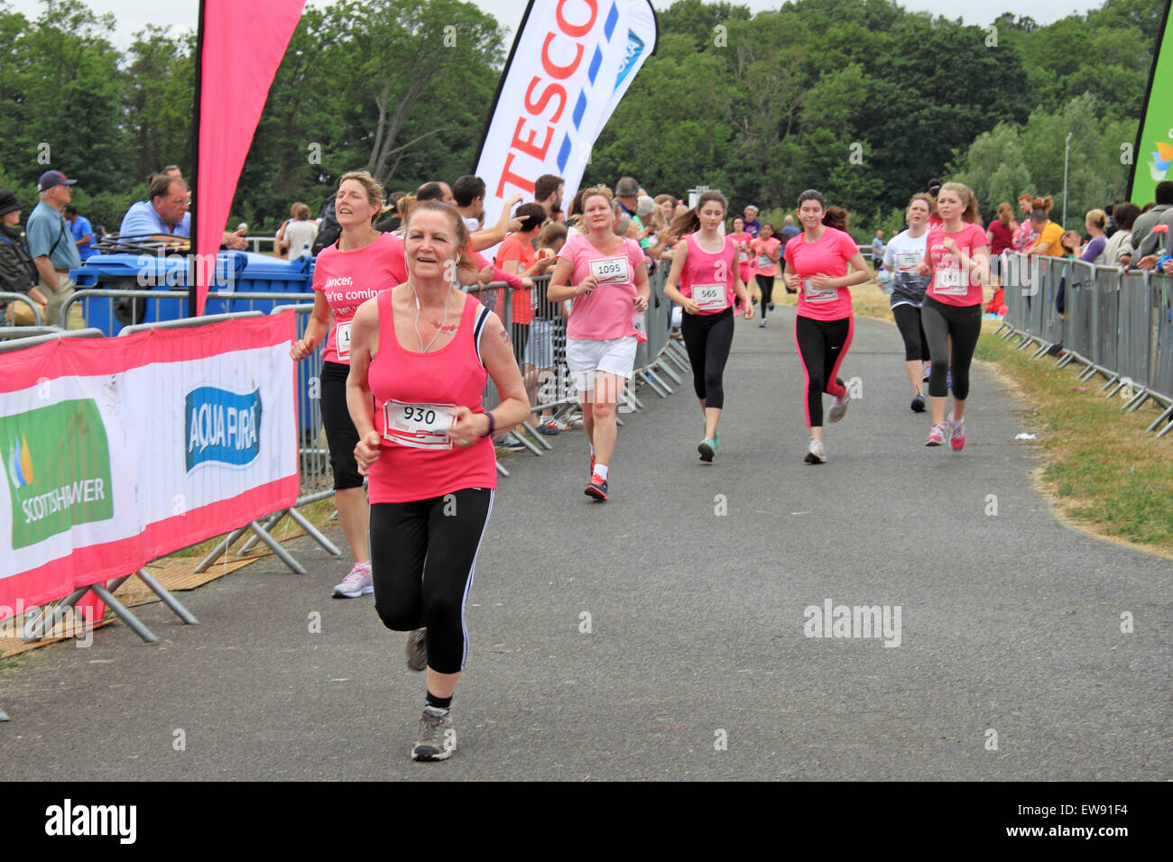 Approaching the finishing line at 'Race for LIfe' women-only charity fundraising running event for Cancer - Stock Image
