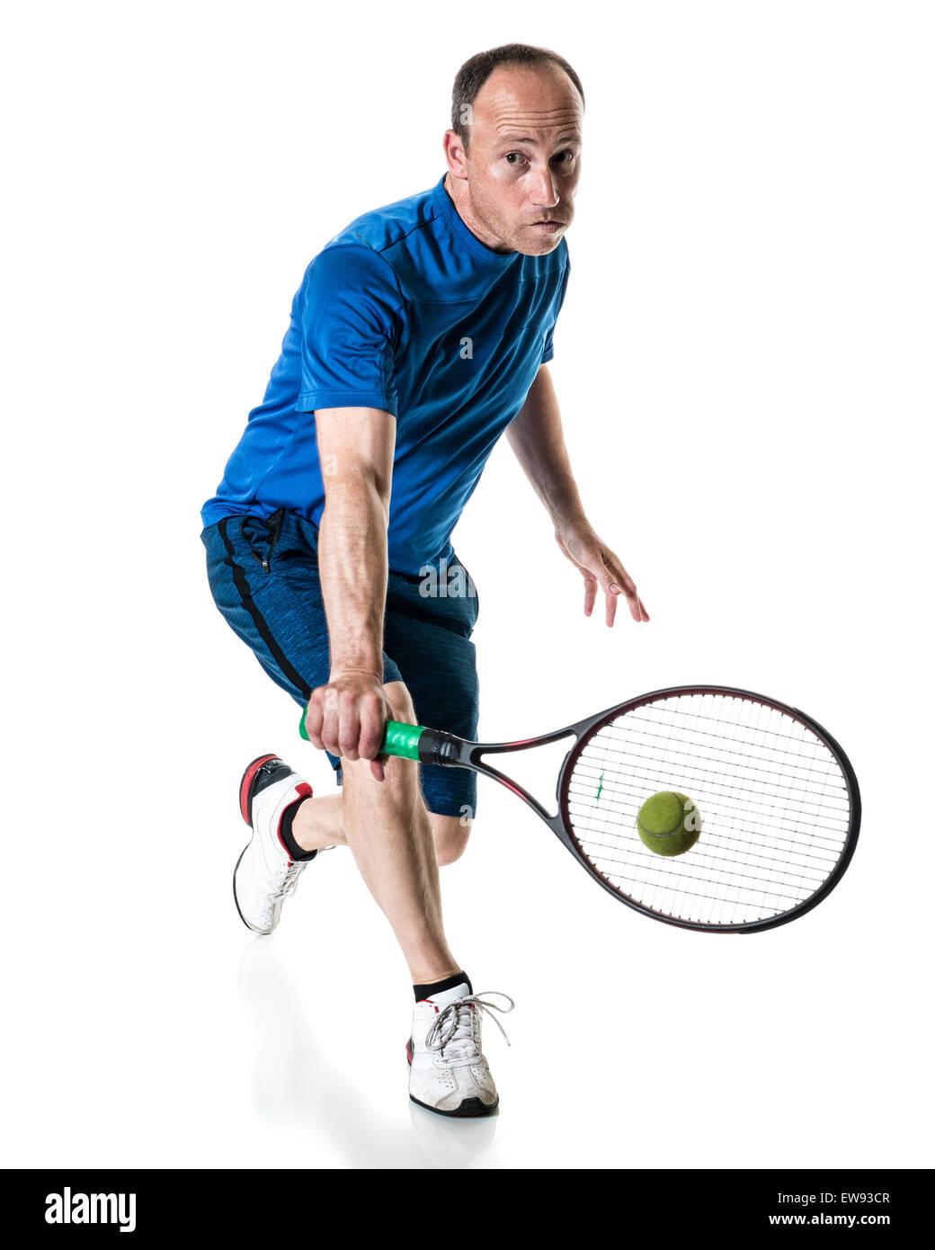 Tennis action shot. Backhand. Studio shot over white. - Stock Image