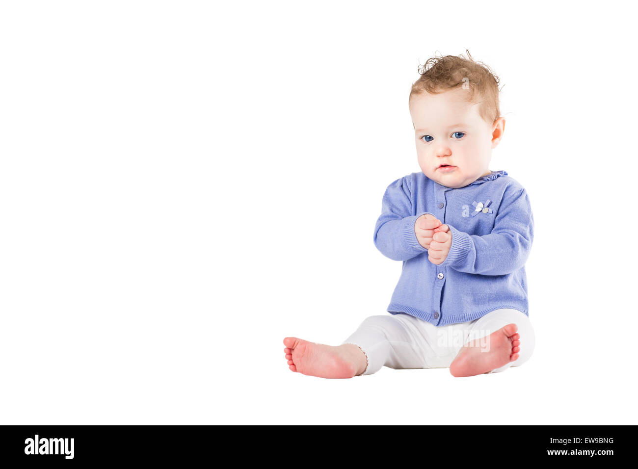 Beautiful baby girl wearing a purple sweater clapping her hands, isolated on white - Stock Image