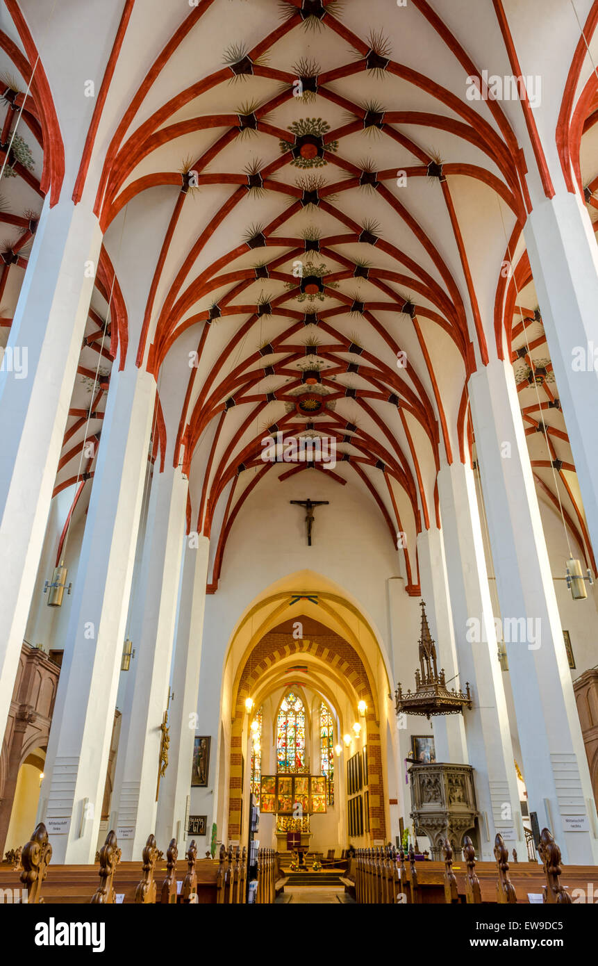 Aisle and altar of Saint Thomas Church in Leipzig.  German composer Johann Sebastian Bach is buried in front of - Stock Image