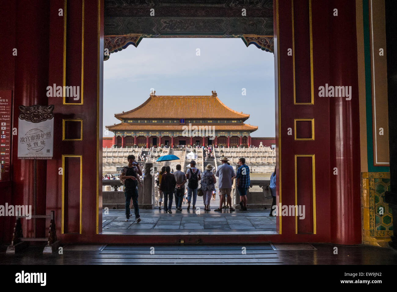 Tourists viewing hall seen through a door - Stock Image