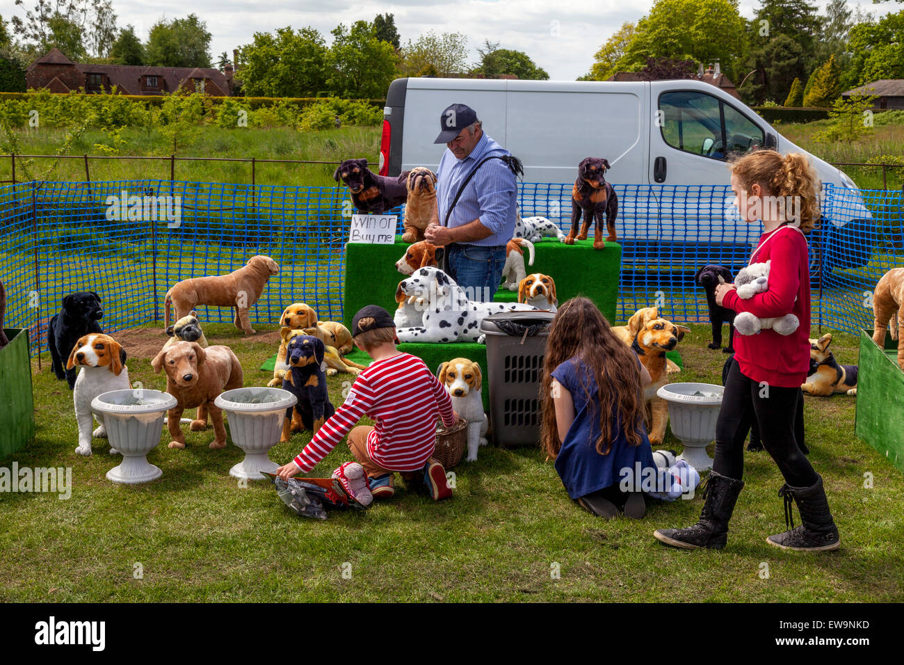 A Man Selling Toy Dogs, Maresfield Fete, Maresfield, Sussex, UK - Stock Image