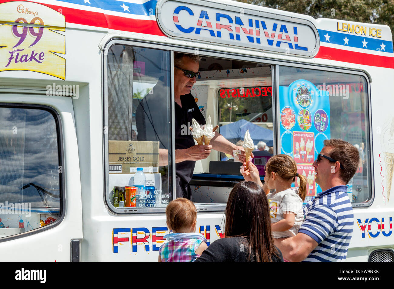 Family Buying Ice Creams From A Traditional Ice Cream Van, Maresfield Fete, Maresfield, Sussex, UK - Stock Image