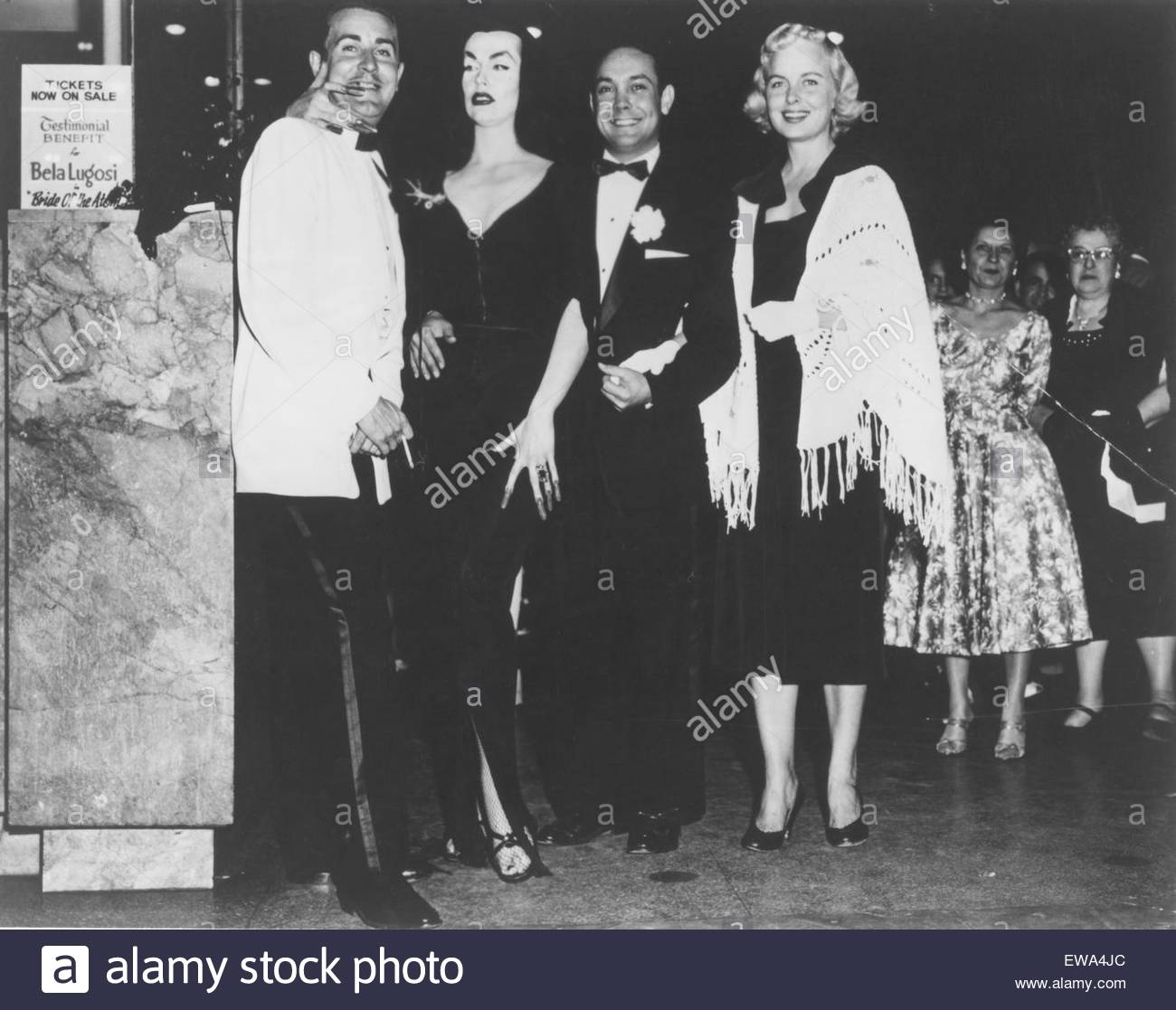 Ed Wood and Vampire (Maila Nurmi) left, pose for photos at an event, circa 1950s. Courtesy Granamour Weems Collection. - Stock Image