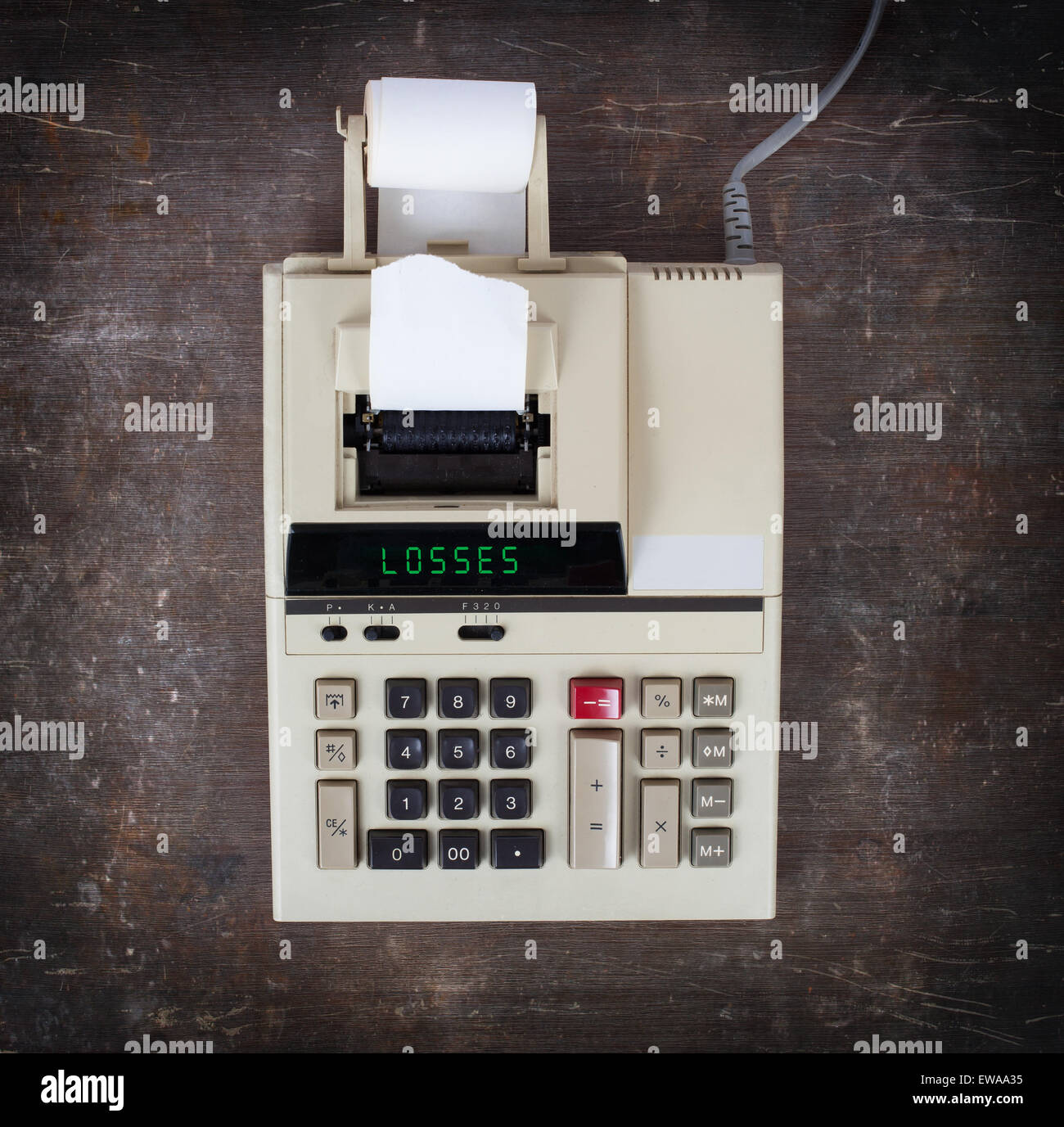 Old calculator showing a text on display - losses - Stock Image