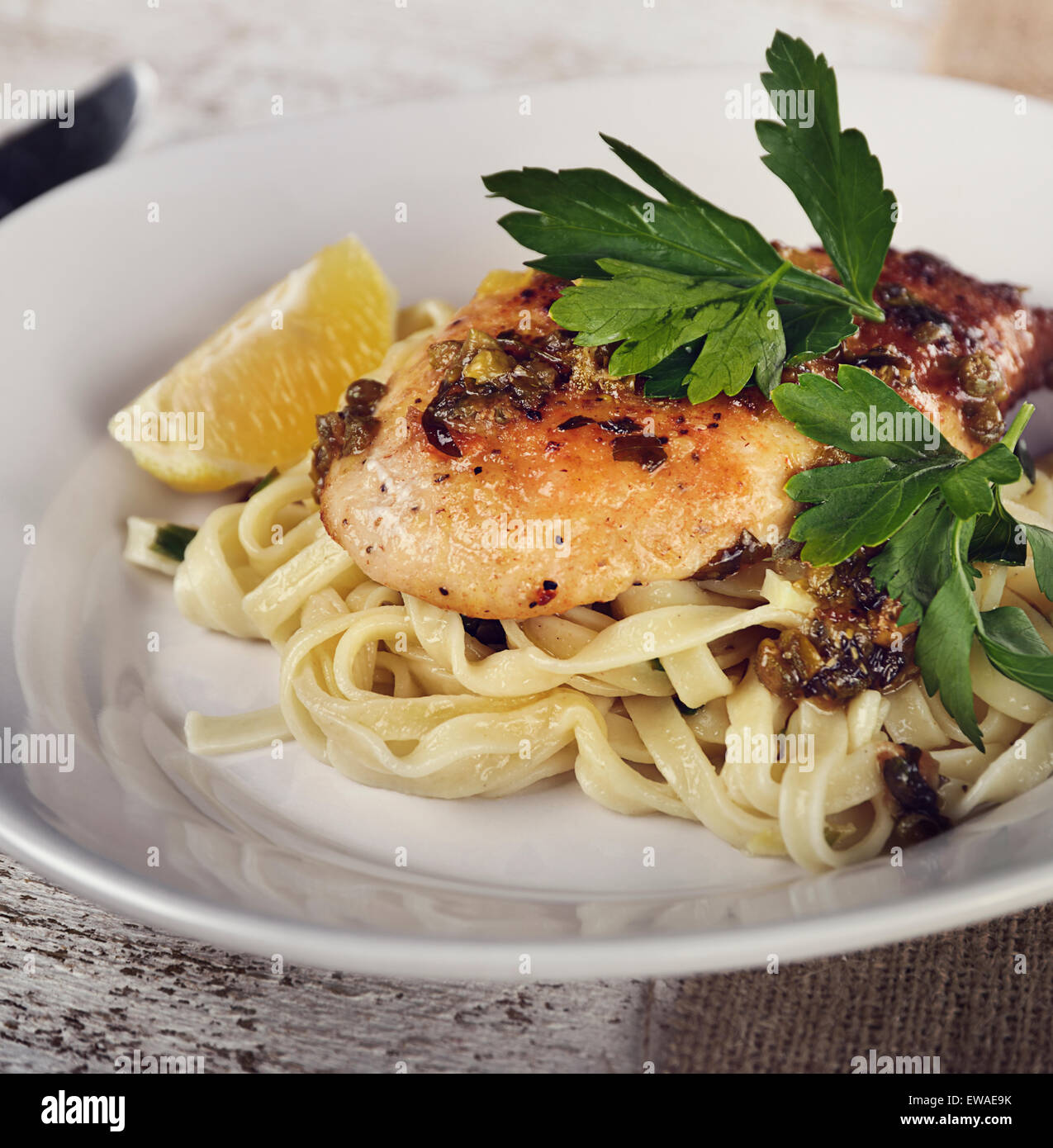 Chicken Fillet With Pasta,Parmesan Cheese And Capers - Stock Image