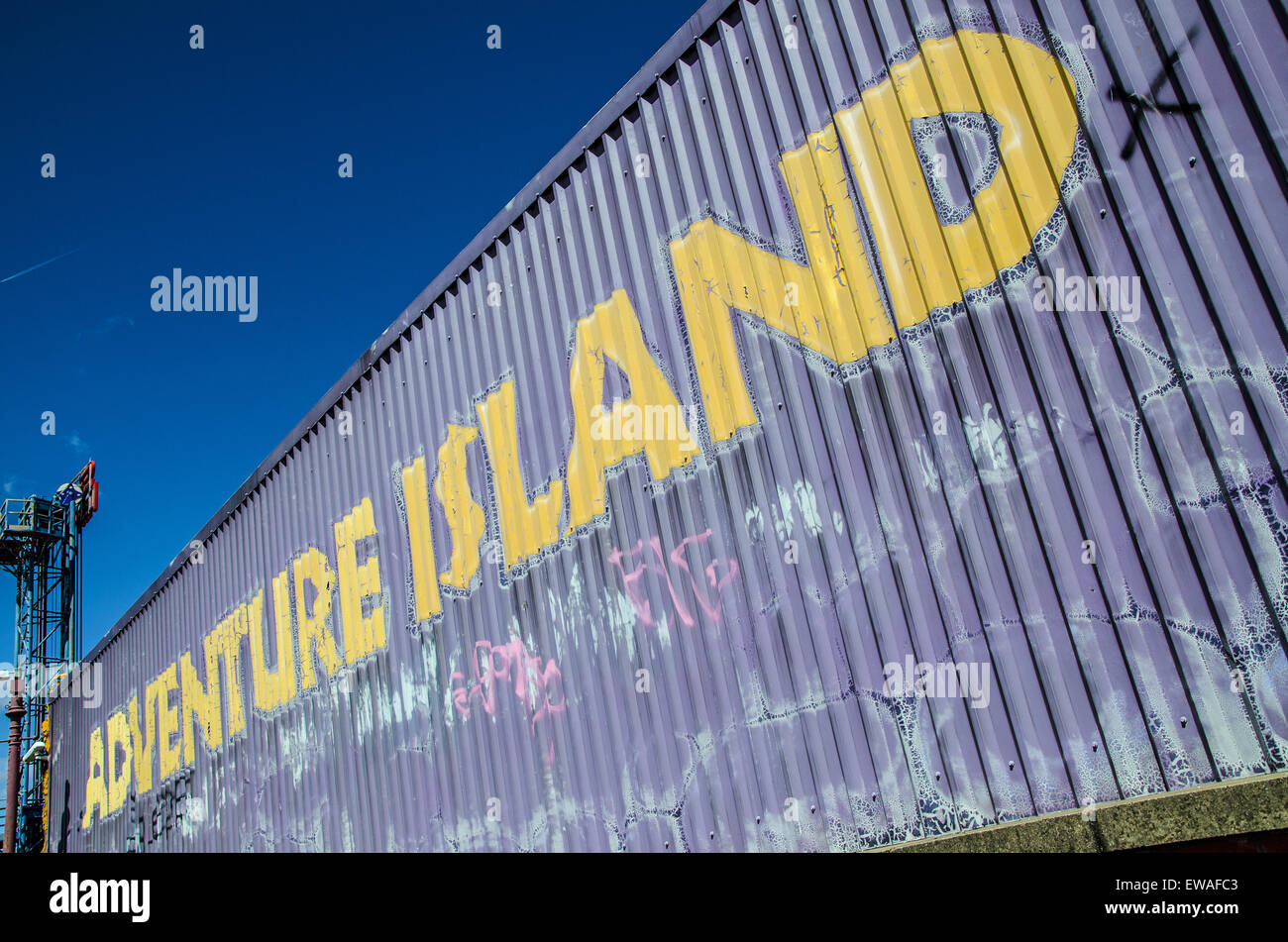 The rear of Adventure Island, Southend, with a weathered and rough sign on corrugated steel. Space for copy - Stock Image
