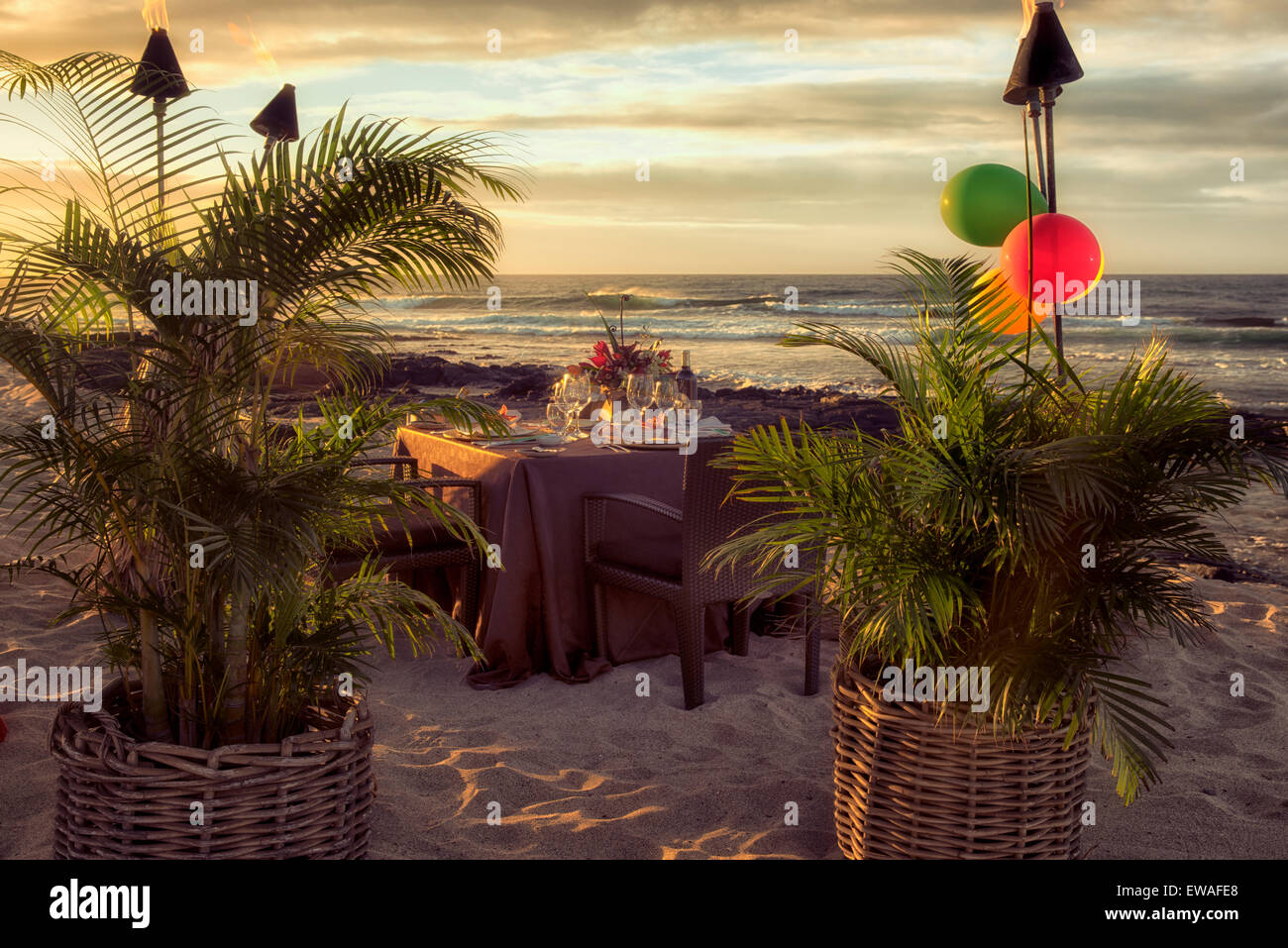 Dinner table set at beach side of the Four Seasons. Hawaii, the big island - Stock Image