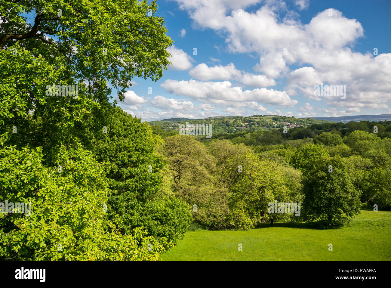 English countryside on a sunny day in June. View towards the village of Broadbottom in Tameside. - Stock Image