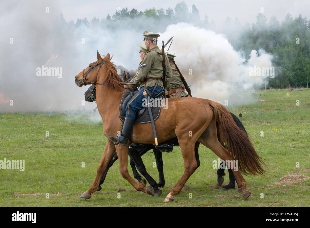 RUSSIA, CHERNOGOLOVKA - MAY 17: Cavalry soldiers ride on History reenactment of battle of Civil War in 1914-1919 - Stock Image